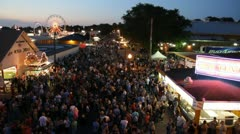 Stock Footage - Iowa State Fair - HD1080p - Flying over crowded streets at night - stock footage
