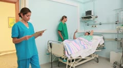 Nurse and doctor talking in the room of patients Stock Footage