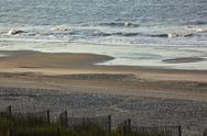Deserted beach scene Stock Photos