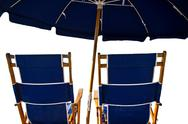 Beach chairs and umbrella isolated on white Stock Photos