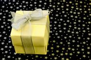 Gift box wrapped with silver ribbon Stock Photos