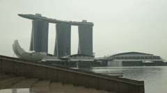 The Marina Bay Sands hotel on a muggy, overcast Singapore day Stock Footage