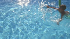 Stock Video Footage of child swims in the pool