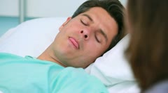 Patient lying on hospital bed Stock Footage