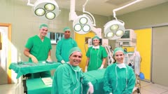 Several Surgeons surrounding an operation table Stock Footage
