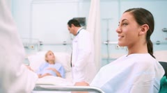 Obstetrician talking to a smiling patient lying in a bed Stock Footage