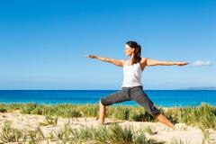 Woman practicing yoga Stock Photos