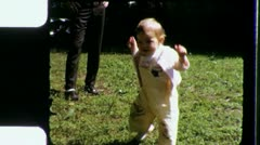 Toddler's FIRST STEP Learning to WALK Toddler 1960s Vintage Film Home Movie 3306 Stock Footage