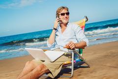 business man on the beach - stock photo
