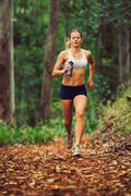 woman running in the forest - stock photo