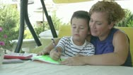 Mother and son doing homework Stock Footage