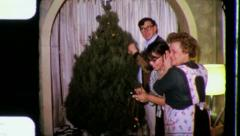 TRIMMING CHRISTMAS TREE Family Decorates 1965 Vintage Old Film Home Movie 3351 Stock Footage