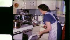Woman Bakes THANKSGIVING TURKEY Christmas 1960s Vintage Film Home Movie 3359 Stock Footage
