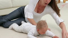 Woman lying with a baby Stock Footage