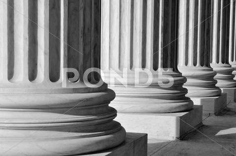Stock photo of pillars of law and information at the united states supreme court