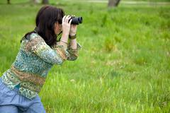 woman observing wildlife - stock photo