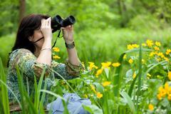 Woman birdwatching Stock Photos