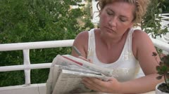 Women solving crossword puzzle - stock footage
