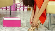 Stock Video Footage of Woman Shopping in Shoe Store