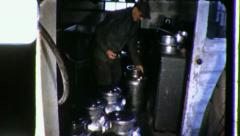 DIARY FARMER in Barn Milk Cans 1970 (Vintage Film Home Movie Amateur) 3404 Stock Footage
