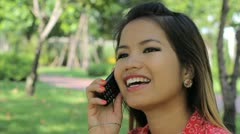 Pretty Asian Girl Talking On Cell Phone - stock footage