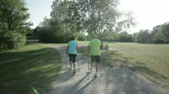 Following senior nordic walkers from behind Stock Footage