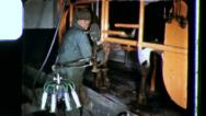 Stock Video Footage of DIARY FARMER Daily Milk Cow Milking 1970 (Vintage Film Home Movie Amateur) 3407