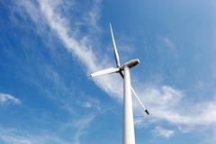 Stock Photo of wind turbines on hight sky