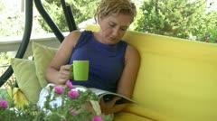 Women reading magazine Stock Footage