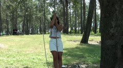 Young woman spinning on rope Stock Footage