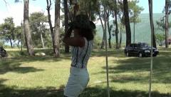 Young woman hanging on rope Stock Footage