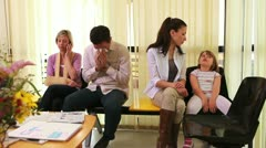 Patients waiting in a waiting room Stock Footage