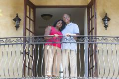 Senior african american man & woman couple on balcony Stock Photos