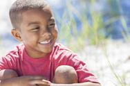 African american boy child happy smiling outside Stock Photos