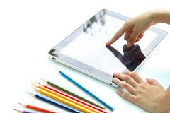 Child hand touch screen tablet Stock Photos