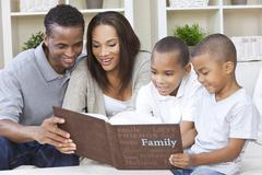 African american family looking at photo album Stock Photos