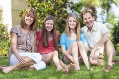 Parents children family healthy sitting in garden Stock Photos