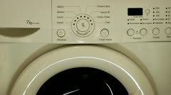 Start of the programmed washing machine in work Stock Footage