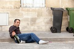 drunk man lying - stock photo