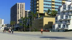 Stock Video Footage of Walkers, Joggers, Bicyclists On Path- Long Beach CA