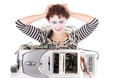 Female clown with broken computer Stock Photos
