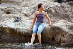 woman on riverbank - stock photo