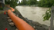 Weather, near flood on river with flood booms wide shot Stock Footage