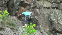 Climbers on the cliffs rising Stock Footage