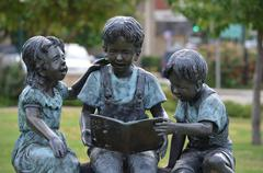Boy Reading Statue - stock photo