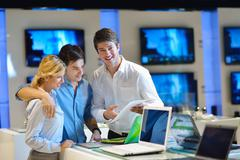 Young couple in consumer electronics store Stock Photos