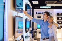 Stock Photo of young couple in consumer electronics store