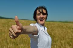 young woman in wheat field at summer - stock photo
