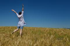 Young woman in wheat field at summer Stock Photos