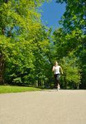 Young beautiful  woman jogging Stock Photos